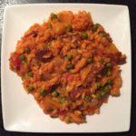 Paella met chorizoworst en garnalen