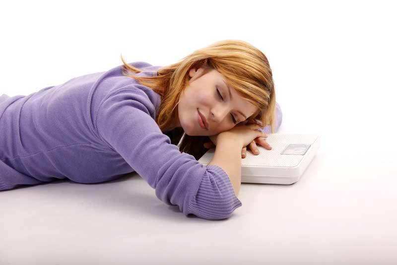 Hoe kan slapen helpen bij afvallen?