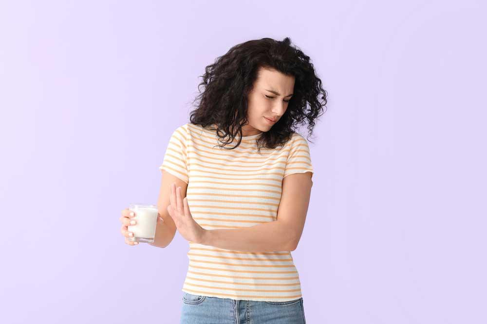 Buikpijn en krampen door zuivel, zoals melk